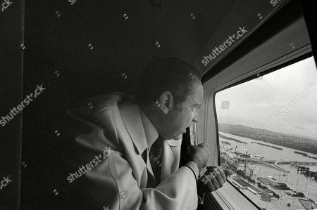 Richard Nixon President Richard M. Nixon makes a helicopter survey of the flooded area around Harrisburg, Penn., after Hurricane Agnes