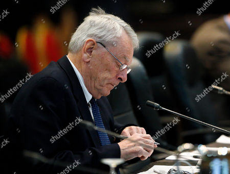 Dick Pound Dick Pound, the author of a report that detailed anti-doping corruption in Russia, prepares during a break in a meeting of the World Anti-Doping Agency in Colorado Springs, Colo. The leader of the track's governing body told a lawyer he'd need to cut a deal with Russian president Vladimir Putin to ensure nine Russian athletes accused of doping wouldn't compete at 2013 world championships in Moscow, according to a new report on the scandal that reached the top of the sport and country. Details of the 89-page investigation, to be released by the World Anti-Doping Agency on Thursday, Jan. 14, were provided to The Associated Press early by a person who had reviewed it. The report was written by Pound