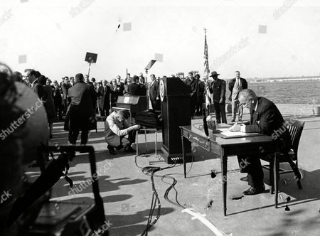 Lyndon Johnson In this Oct. 3, 1965 photo, U.S. President Lyndon B. Johnson, far right, sits at his desk on Liberty Island in New York Harbor as he signs a new immigration bill. According to a report released by the Pew Research Center, 59 million people have come to the U.S. since 1965 after President Johnson signed the Immigration Act