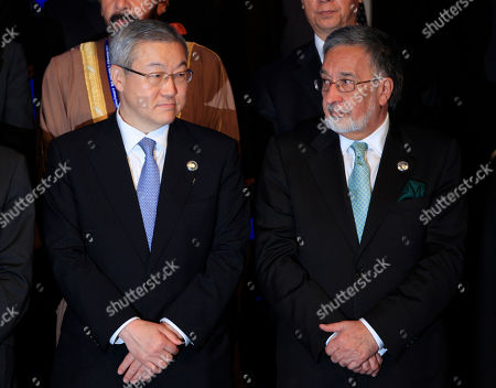 Kim Sung-hwan, Zalmai Rassoul South Korean Foreign Minister Kim Sung-hwan, left, stands with his Afghan counterpart Zalmai Rassoul as they prepare for a group photo during the Bali Democracy Forum in Nusa Dua, Bali, Indonesia