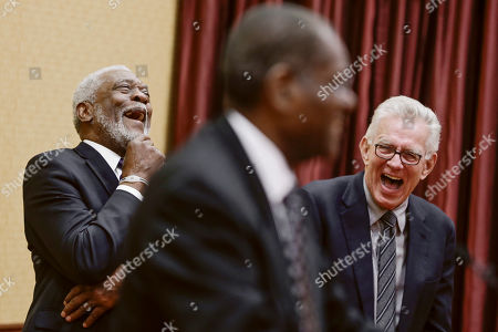 Stock Photo of Bob Gibson, Bill White, Tim McCarver Former baseball players Bill White, left, and Tim McCarver, right, react to a joke by Bob Gibson before a charity banquet, in La Vista, Neb