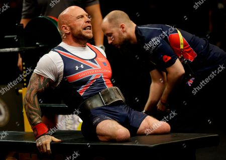 Men's lightweight powerlift gold medal winner Michael Yule, of United Kingdom, prepares for lift in the competition at the Invictus Games, in Kissimmee, Fla