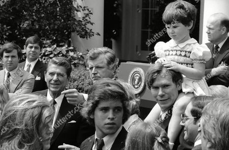 Stock Picture of Meghan Kennedy Townsend, daughter of Kathleen Kennedy Townsend, who is the daughter of Robert Kennedy, sits on the shoulders of her dad David in the Rose Garden of the White House after a presentation of the Robert F. Kennedy Medal by President Ronald Reagan to Kennedy's wife Ethel for public service, . At left is Pres. Reagan and Sen. Ted Kennedy (D-Mass