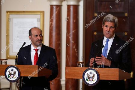 Ahmad al-Jarba, John Kerry Secretary of State John Kerry and Ahmad al-Jarba, president of Syria's main opposition bloc, speak to reporters at the State Department in Washington, . In addition to speaking about Syria, Kerry commented on the situation of kidnapped school girls in Nigeria