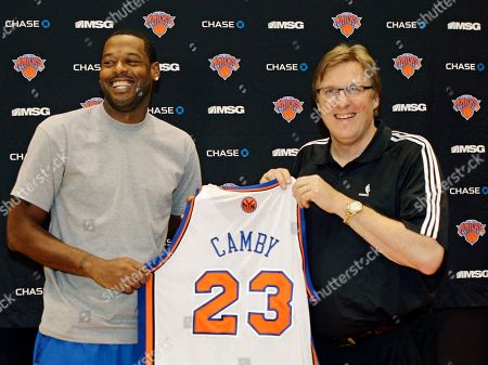 Marcus Camby, Glen Grunwald Newly acquired New York Knicks center Marcus Camby, left, poses with executive vice president and general manager Glen Grunwald following a news conference at the team's training facility in Tarrytown, N.Y