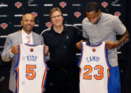 Stock Picture of Jason Kidd, Marcus Camby, Glen Grunwald Jason Kidd, left, and Marcus Camby, right, pose with their new jerseys and New York Knicks general manager Glen Grunwald after the team announced their newest signees at the team's training facility in Tarrytown, N.Y