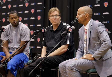 Stock Image of Marcus Camby, Jason Kidd, Glen Grunwald Marcus Camby, left, and New York Knicks general manager Glen Grunwald listen to Jason Kidd, right, during a news conference introducing the Knicks newest signees at the team's training facility in Tarrytown, N.Y., . This is Camby's second time as a Knicks