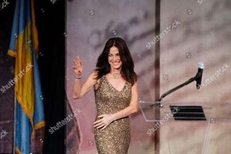 Kim Delaney Actress Kim Delaney waves as she arrives on stage to speak before former Secretary of Defense Robert Gates receives the Liberty Medal during a ceremony at the National Constitution Center in Philadelphia. Since 1989, the Liberty Medal has been given annually to individuals or organizations whose actions strive to bring liberty to people worldwide