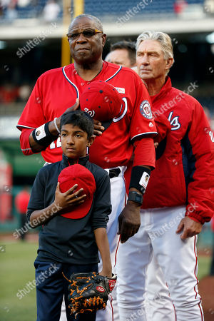 Tariq Ali, Dusty Baker Tariq Ali, 10, from Washington, stands with Washington Nationals manager Dusty Baker and others during the national anthem before the second baseball game of a split doubleheader against the Miami Marlins at Nationals Park, in Washington