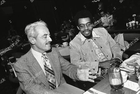 Marvin Miller, left, of the baseball players association, and Dave Cash of the Philadelphia Phillies chat at a luncheon prior to a meeting with other baseball players regarding delayed opening of Spring training. Miller had meet earlier in the day with league presidents and club owners representatives. The meetings were held, in Philadelphia