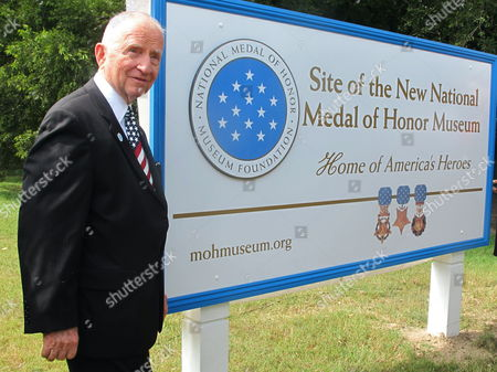 Billionaire businessman and former presidential candidate H. Ross Perot poses next to a sign designating the site of the future National Medal of Honor Museum at the Patriots Point Naval and Maritime Museum in Mount Pleasant, S.C. on . Perot visited to discuss plans for the $100 million museum. Organizers say he has donated millions to the effort but would not say specifically how much. Organizers hope to break ground next year