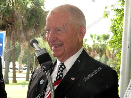 Billionaire businessman and former presidential candidate H. Ross Perot laughs during comments he made at the site of the future National Medal of Honor Museum at the Patriots Point Naval and Maritime Museum in Mount Pleasant, S.C. on . Perot visited to discuss plans for the $100 million museum. Organizers say he has donated millions to the effort but would not say specifically how much. Organizers hope to break ground next year