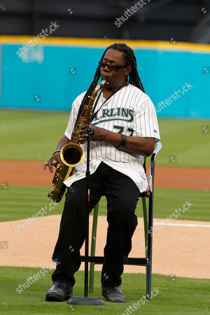 Clarence Clemons Clarence Clemons warms up before playing the national anthem before an opening day baseball game between the Florida Marlins and New York Mets in Miami