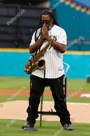 Clarence Clemons Clarence Clemons stands for a moment of silence for the people of Japan before playing the national anthem before an opening day baseball game between the Florida Marlins and New York Mets in Miami