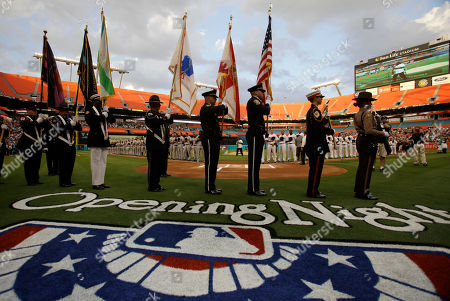 Clarence Clemons Clarence Clemons performs the national anthem before an opening day baseball game between the Florida Marlins and New York Mets in Miami