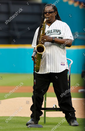 Clarence Clemons Clarence Clemons plays the national anthem before an opening day baseball game between the Florida Marlins and New York Mets in Miami