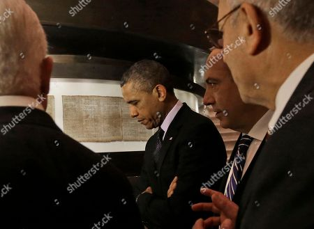 Barack Obama US President Barack Obama views the Dead Sea Scrolls with Israeli Prime Minister Benjamin Netanyahu, 2nd right, at the Israel Museum in Jerusalem, Israel, and with Director of the Museum, James Snyder, far right and Yitzhak Molcho, left, Senior Advisor to Netanyahu. After a visit to Israel's national museum to inspect the Dead Sea Scrolls, which highlight the Jewish people's ancient connection to the land that is now Israel, Obama headed to the West Bank to tell the Palestinians that the creation of a Palestinian state remains a priority for his administration