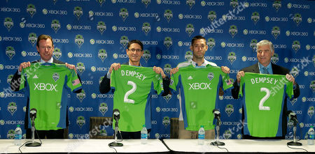 Clint Dempsey, Sigi Schmid, Adrian Hanauer, Peter McLoughlin Clint Dempsey, second from right, stands with Seattle Sounders head coach Sigi Schmid, right, president Peter McLoughlin, left, and general manager Adrian Hanauer, second from left, as Dempsey is introduced as the newest player for the MLS soccer team, in Seattle. Dempsey previously played for Tottenham Hotspur in the English Premier League