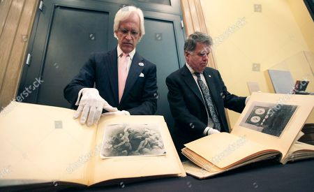 David S. Ferriero, Robert M. Edsel David S. Ferriero, archivist of the United States, right, and Robert M. Edsel, founder and president of Monuments Men Foundation for the Preservation of Art, show two newly discovered albums containing photographs of art works and furniture stolen by the Nazis during World War II after they were unveiled at a news conference in the Meadows Museum at SMU in Dallas. The Dallas-based Monuments Men Foundation for the Preservation of Art says it is closing due to a lack of funds