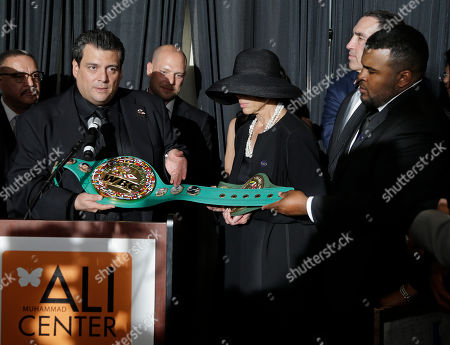 Mauricio Sulaiman, Lonnie Ali, Assaad Ali Mauricio Sulaiman, president of the World Boxing Council, left, presents a WBC championship belt to Lonnie Ali, center, and her son, Assaad Ali, right, at the Muhammad Ali Center, in Louisville, Ky