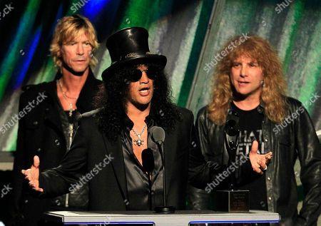 Slash, Duff McKagan, Steven Adler Guitarist Slash gestures with Duff McKagan, back left, and Steven Adler after Guns N' Roses was inducted into the Rock and Roll Hall of Fame, in Cleveland
