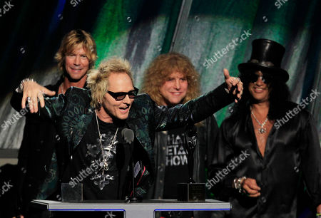 Matt Sorum, Duff McKagan, Steven Adler, Slash Matt Sorum gestures as Duff McKagan, back left, Steven Adler and Slash, back right, watch, after Guns N' Roses was inducted into the Rock and Roll Hall of Fame, in Cleveland