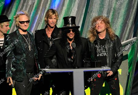 Matt Sorum, Duff McKagan, Slash, Steven Adler Guns N' Roses from left: Matt Sorum, Duff McKagan, Slash and Steven Adler celebrate induction into the Rock and Roll Hall of Fame, in Cleveland
