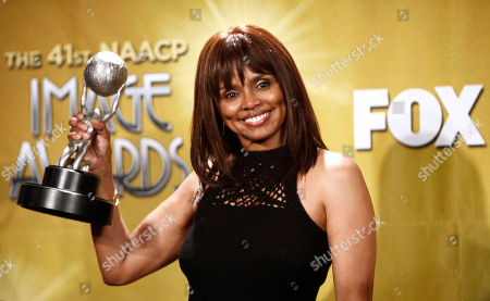Stock Photo of Debbi Morgan Debbi Morgan poses backstage with the award for outstanding actress in a daytime drama series at the 41st NAACP Image Awards, in Los Angeles