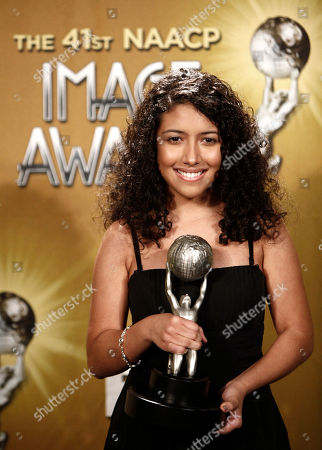 """Stock Picture of Caitlin Sanchez Caitlin Sanchez poses with the award for outstanding performance in a youth/children's program for """"Dora the Explorer,"""" at the 41st NAACP Image Awards, in Los Angeles"""