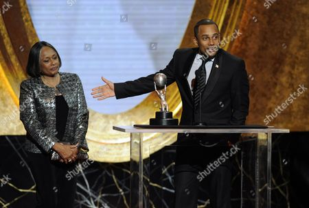 Marilyn Hill, Hill Harper Hill Harper accepts the award for outstanding actor in a drama series at the 40th NAACP Image Awards, in Los Angeles. Looking on at left is his mother Marilyn Hill