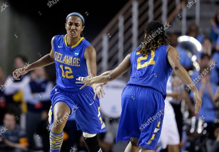Danielle Parker, Trumae Lucas Delaware forward Danielle Parker (12) high-fives teammate Trumae Lucas after scoring during the first half of a second-round game against North Carolina in the women's NCAA college basketball tournament in Newark, Del