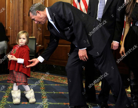 Stock Image of John Boehner, Sophia Schilling Sophia, left, the three-year-old daughter of Rep. Bobby Schilling, R-Ill., not pictured, refuses to take part in a ceremonial swearing in with House Speaker John Boehner of Ohio, on Capitol Hill in Washington