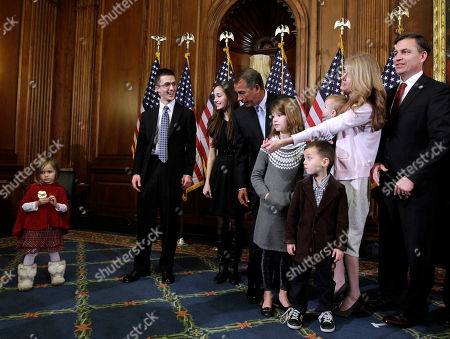 John Boehner, Bobby Schilling, Sophia Schilling Sophia, left, the three-year-old daughter of Rep. Bobby Schilling, R-Ill., far right, refuses to take part in a ceremonial swearing in with House Speaker John Boehner of Ohio, on Capitol Hill in Washington