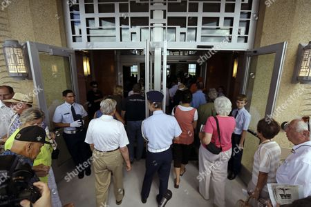 Visitors enter after a rededication ceremony for the restoration of the main terminal of Lakefront Airport in New Orleans, . Noted for its historic art deco design from 1933, it was a stop for Amelia Earhart on her final, fateful attempt to fly around the world in 1937. The building was largely altered as a nuclear fallout shelter in 1964, covering most if its original design. Nineteen million dollars in federal funds were used for the restoration after it was flooded during Hurricane Katrina