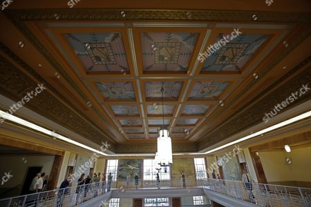Patrons walk along an upstairs balcony after a rededication ceremony for the restoration of the main terminal of Lakefront Airport in New Orleans, . Noted for its historic art deco design from 1933, it was a stop for Amelia Earhart on her final, fateful attempt to fly around the world in 1937. in New Orleans, Saturday, Sept. 28, 2013. The building was largely altered as a nuclear fallout shelter in 1964, covering most if its original design. Nineteen million dollars in federal funds were used for the restoration after it was flooded during Hurricane Katrina