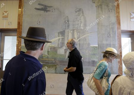 Visitors look at one of several original murals after a rededication ceremony for the restoration of the main terminal of Lakefront Airport in New Orleans, . Noted for its historic art deco design from 1933, it was a stop for Amelia Earhart on her final, fateful attempt to fly around the world in 1937. The building was largely altered as a nuclear fallout shelter in 1964, covering most if its original design. Nineteen million dollars in federal funds were used for the restoration after it was flooded during Hurricane Katrina