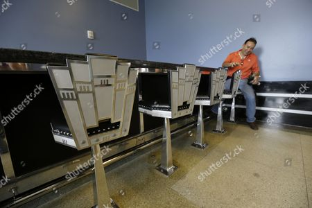 Juan Asturas, a flight instructor, looks new bar stools in the soda fountain inside the newly rededicated ceremony for the restoration of the main terminal of Lakefront Airport in New Orleans, . Noted for its historic art deco design from 1933, it was a stop for Amelia Earhart on her final, fateful attempt to fly around the world in 1937. The building was largely altered as a nuclear fallout shelter in 1964, covering most if its original design. Nineteen million dollars in federal funds were used for the restoration after it was flooded during Hurricane Katrina