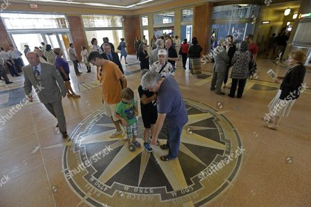 Visitors look at a compass on the main floor after a rededication ceremony for the restoration of the main terminal of Lakefront Airport in New Orleans, . Noted for its historic art deco design from 1933, it was a stop for Amelia Earhart on her final, fateful attempt to fly around the world in 1937. The building was largely altered as a nuclear fallout shelter in 1964, covering most if its original design. Nineteen million dollars in federal funds were used for the restoration after it was flooded during Hurricane Katrina
