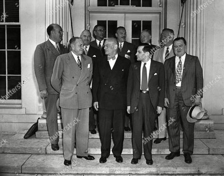 Stock Photo of These New York congressmen pause at the White House door, Washington, after calling on President Truman to urge that he insist upon the immigration of 100,000 Jews into Palestine. From left to right are: Front, Reps. Charles A. Buckley (D); Emanuel Celler (D); Vito Maro-Antonio (AL), Donald L. O'Toole (D); Rear, Leonard W. Hall (R); John J. Rooney (D); Leo F. Rayfield (D); Arthur G. Klein (D); William T. Byrne (D) and Walter A. Lynch (D