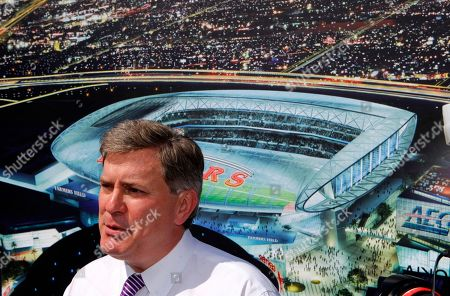 Tim Leiweke Tim Leiweke, President of Anschutz Entertainment Group, AEG stands before an artist's conception of a proposed NFL stadium during a bill-signing ceremony by Calif. Gov. Jerry Brown in Los Angeles. Entertainment firm AEG announced, they have requested a six-month extension of the company's agreements with the city of Los Angeles to build a professional football stadium near Staples Center so they can continue negotiations with the NFL to secure a team. AEG's agreements with the city are set to expire on Oct. 18