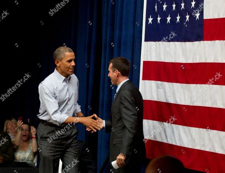 Barack Obama, David Plouffe President Barack Obama is greeted by David Plouffe as he arrives to speak at a campaign event at Bridgeport Art Center, in Chicago