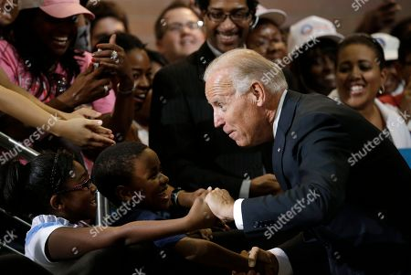 Stock Picture of Joe Biden, Madison King, Lawrence Smith Vice President Joe Biden greets Lawrence Smith, 8, and Madison King, 9, both of Van Buren Township, Mich., during a campaign stop at Renaissance High School, in Detroit
