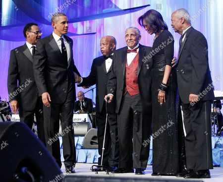 Barack Obama, Michelle Obama, Emanuel Cleaver, John Lewis, Joseph Lowery, Donald Payne President Barack Obama, second left, and first lady Michelle Obama, second from right, join Rep. Emanuel Cleaver II, D-Mo., left, Rep. John Lewis, D-Ga., third from left, civil rights leader Rev. Joseph E. Lowery, fourth from left, and CBC Foundation Chairman Rep. Donald M. Payne, D-N.J., right, on the stage during the Congressional Black Caucus Foundation Foundation Annual Phoenix Awards in Washington