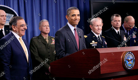 Barack Obama, Leon Panetta, Martin Dempsey, John McHugh President Barack Obama smiles at the conclusion of his news briefing on the defense strategic guidance, at the Pentagon. From left are, Army Gen. Raymond T. Odierno, Defense Leon Panetta, Marine Corps Commandant James Amos, the president, and Joint Chiefs Chairman Gen. Martin E. Dempsey