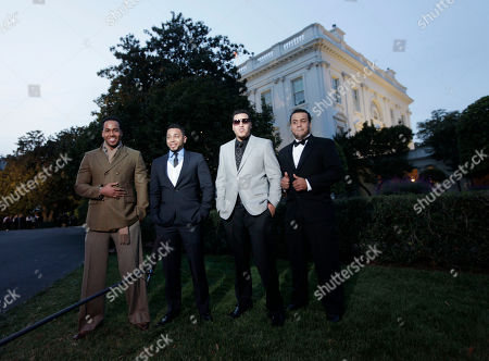 Romeo Santos, Lenny Santos, Max Santos, Henry Santos Members of the band Aventura from left, Romeo Santos, Henry Santos, Max Santos, and Lenny Santos, stand on the South Lawn of the White House in Washington, . The group are participants for tonight's 'in Performance at the White House: Fiesta Latina', celebrating Hispanic musical heritage during National Hispanic Heritage Month