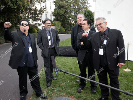 David Hidalgo, Cesar Rosas, Louie Perez, Steve Berlin, Conrad Lozano Members of the band Los Lobos, from left, Cesar Rosas, Steve Berlin, David Hidalgo, Louie Perez, and Conrad Lozano stand on the South Lawn of the White House in Washington, . Los Lobos are participants for tonight's 'in Performance at the White House: Fiesta Latina', celebrating Hispanic musical heritage during National Hispanic Heritage Month