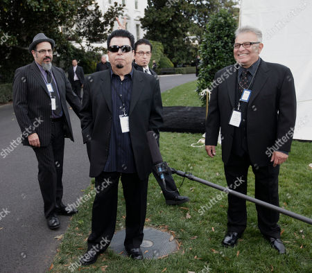 Cesar Rosas, Louie Perez, Steve Berlin, Conrad Lozano Members of the band Los Lobos, from left, Steve Berlin, Cesar Rosas, Louie Perez, and Conrad Lozano stand on the South Lawn of the White House in Washington, . Los Lobos are participants for tonight's 'in Performance at the White House: Fiesta Latina', celebrating Hispanic musical heritage during National Hispanic Heritage Month