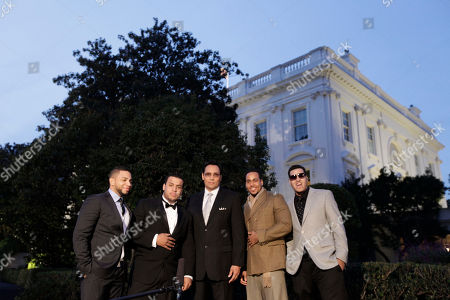 Romeo Santos, Lenny Santos, Max Santos, Henry Santos, Jimmy Smits Actor Jimmy Smits, center, poses with members of the band Aventura from left, Henry Santos, Lenny Santos, Romeo Santos, and Max Santos, on the South Lawn of the White House in Washington, . The group is a participant for tonight's 'in Performance at the White House: Fiesta Latina', celebrating Hispanic musical heritage during National Hispanic Heritage Month, an event Smits is hosting