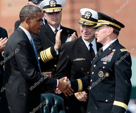 Barack Obama, Martin Dempsey, Mike Mullen President Barack Obama shakes hands with new Joint Chiefs Chairman Gen. Martin Dempsey, right, as retiring chairman Adm. Mike Mullen looks on at center, as they take part in a 'Change of Office' Chairman of the Joint Chiefs of Staff ceremony, at Ft. Myer in Arlington, Va
