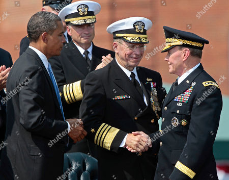 Barack Obama, Martin Dempsey, Mike Mullen President Barack Obama watches as retiring Joint Chiefs Chairman Adm. Mike Mullen, center, shakes hand with incoming Joint Chiefs Chairman Gen. Martin Dempsey, during a 'Change of Office' Chairman of the Joint Chiefs of Staff ceremony at Ft. Myer in Arlington, Va., Friday, Sept., 30, 2011